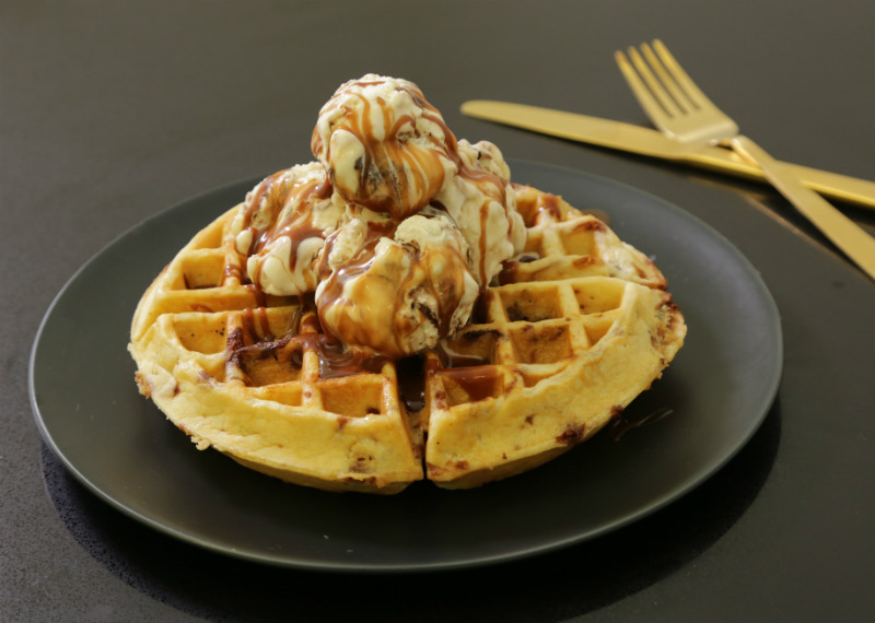 Chocolate speckled waffles with tin roof ice cream