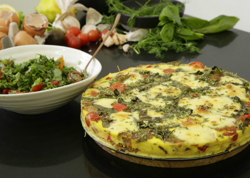 Ratatouille style frittata with tomato and herb salad