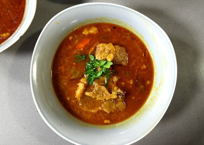Curried oxtail, samp and bean soup