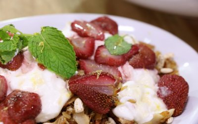 Homemade granola with yoghurt and strawberries