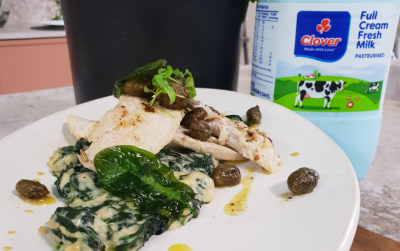 Poached fish with creamy spinach
